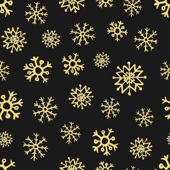 Bezszwowe tło ręcznie rysowane płatki śniegu. złote płatki śniegu na ciemnym tle. elementy dekoracji świątecznych i noworocznych. ilustracja wektorowa.