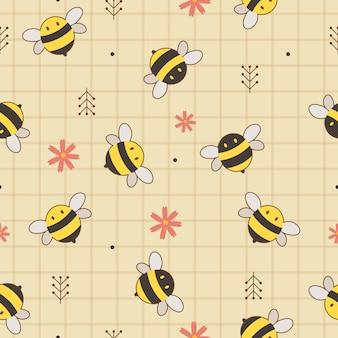 Bezszwowe tło słodkie żółte i czarne pszczoły z kwiatami