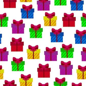 Bezszwowe tło z kolorowymi prezentami na białym tle