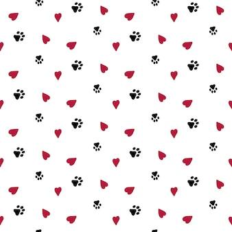 Bezszwowe tło z serca i pies ślad.