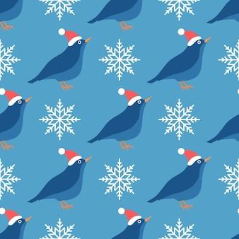 Bezszwowe wektor wzór ptaka w kapeluszu z płatkami śniegu na niebieskim tle świąt bożego narodzenia