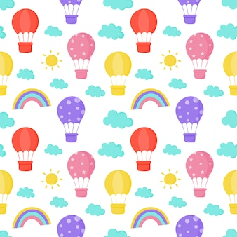 Bezszwowe wzór słońca, balon, tęcza i chmury tapety