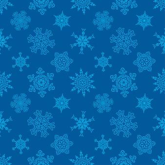 Bezszwowy bożenarodzeniowy błękita wzór z patroszonymi płatkami śniegu