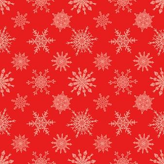 Bezszwowy bożenarodzeniowy czerwony bezszwowy wzór z patroszonymi płatkami śniegu