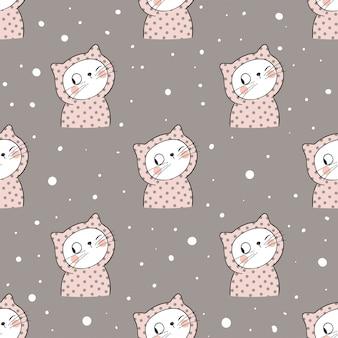 Bezszwowy deseniowy kot w śniegu na brown pastelu