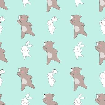 Bezszwowy deseniowy królik i niedźwiedź na zielonym pastelu.