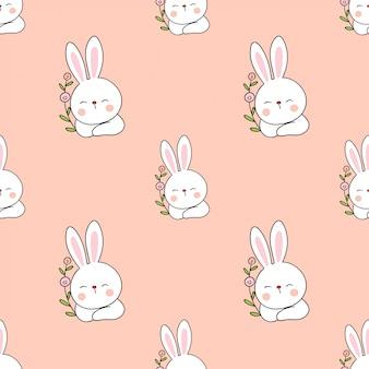 Bezszwowy deseniowy królik z kwiatem.