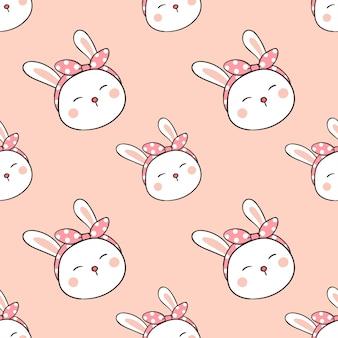 Bezszwowy deseniowy królik z łękiem na głowie w słodkim pastelu
