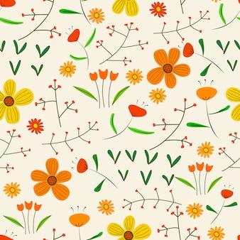 Bezszwowy deseniowy tło z kwiatami i liśćmi.