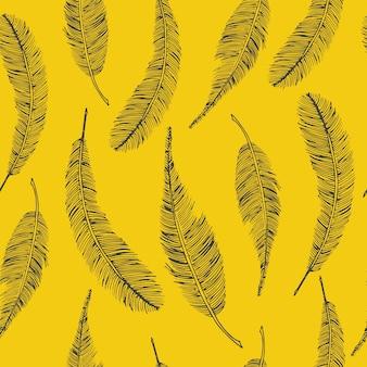 Bezszwowy etniczny wzór z piórkami na kolorze żółtym