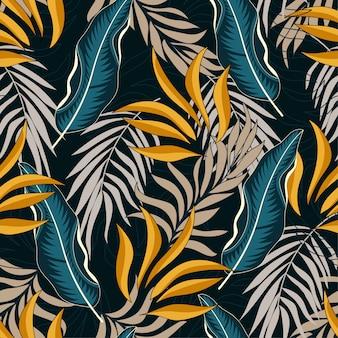 Bezszwowy tropikalny wzór z jaskrawymi żółtymi i błękitnymi liśćmi i roślinami