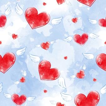 Bezszwowy wektoru wzór z akwareli tekstury czerwonymi sercami z skrzydłami i błękitnym tłem.