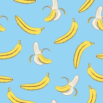 Bezszwowy wzór banany na błękitnym tle.