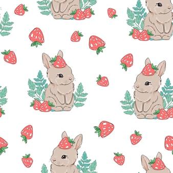 Bezszwowy wzór śliczny królik z truskawką na białym tle. słodka jagoda.