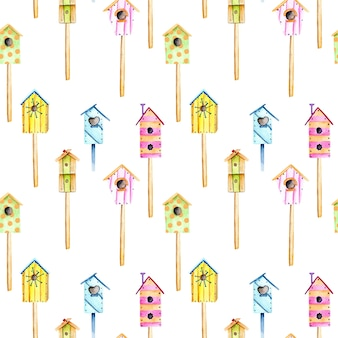 Bezszwowy wzór z akwareli kolorowymi birdhouses