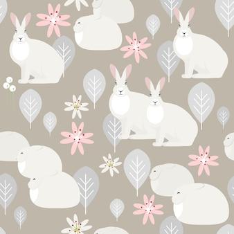 Bezszwowy wzór z białymi królikami