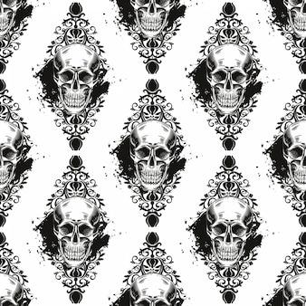 Bezszwowy wzór z czaszkami na białym tle.