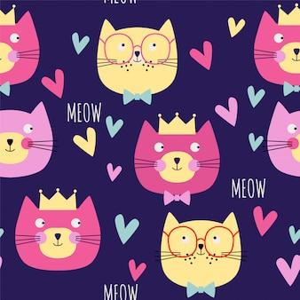 Bezszwowy wzór z kotów głowami i sercami.