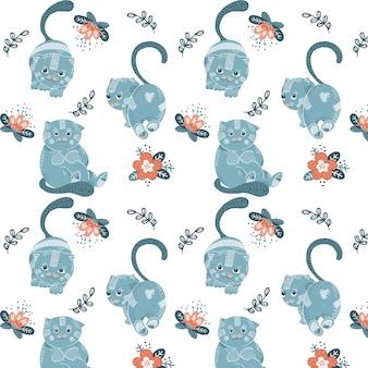 Bezszwowy wzór z kreskówek błękitnymi kotami i kwiatami