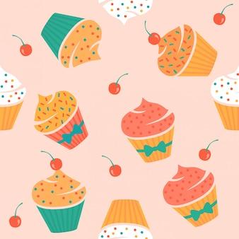 Bezszwowy wzór z muffins i wiśniami.