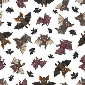 Bezszwowy wzór z nietoperzem w różny pozować