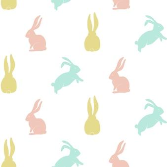 Bezszwowy wzór z śliczną królik sylwetką.