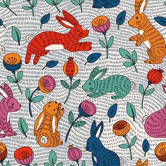Bezszwowy wzór z ślicznym kolorowym królikiem