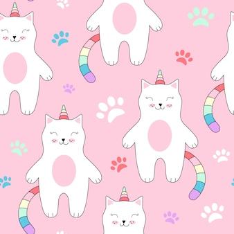 Bezszwowy wzór z ślicznymi kotami jednorożec.