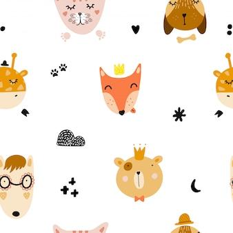 Bezszwowy wzór z ślicznymi zwierzęcymi twarzami.