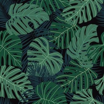 Bezszwowy wzór z tropikalnymi liśćmi na zmroku.