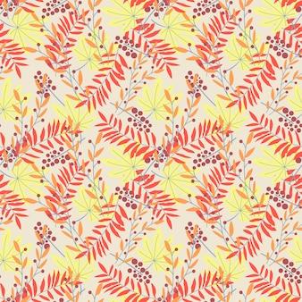 Bezszwowy wzór z żółtymi i czerwonymi tropikalnymi liśćmi