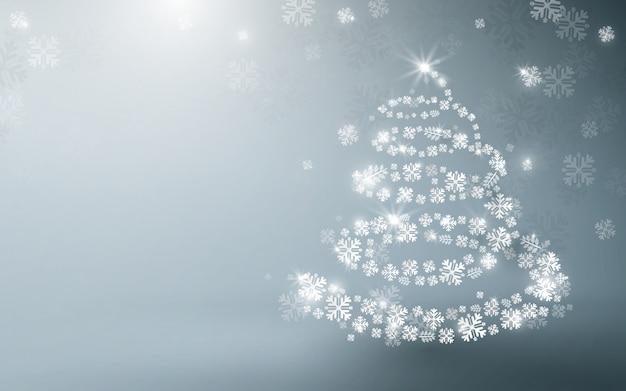 Biała choinka i musujące światła girlanda i spadające płatki śniegu w tle.