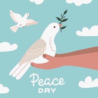 Biała gołębica z gałązką oliwną siedzącą w ludzkich rękach. znak pokoju. logo na białym tle gołębi. godło białego latającego ptaka. flat dove flat sign. dzień pokoju ilustracja z niebem i chmurami.