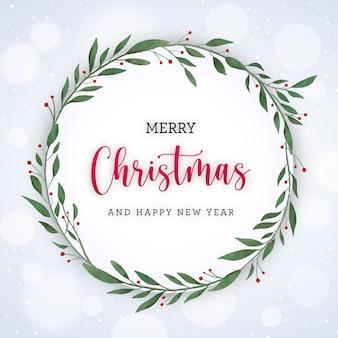 Biała kartka świąteczna z wieńcem akwarela i śniegiem