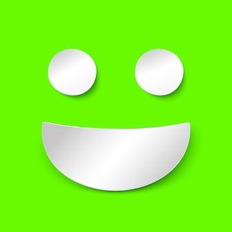 Biała księga uśmiech na zielonym tle. ilustracja w stylu papieru z cieniem. wektor szczęśliwy pozytywny