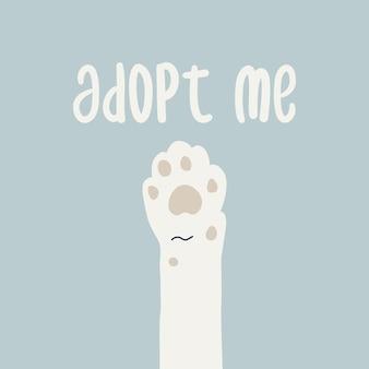 Biała łapa kota i tekst adoptuj mnie