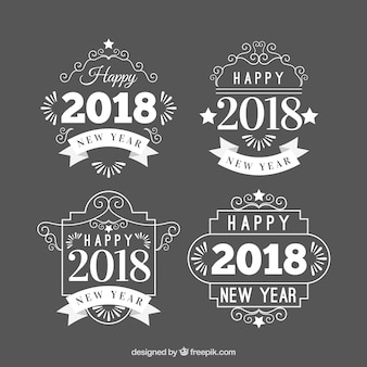 Biała nowy rok odznaki na szarym tle