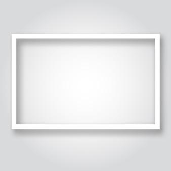 Biała pusta rama papieru z cieniem. copyspace