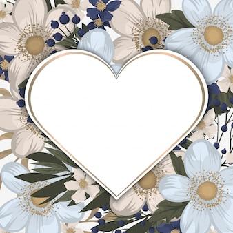 Biała ramka w kształcie serca z kwiatami