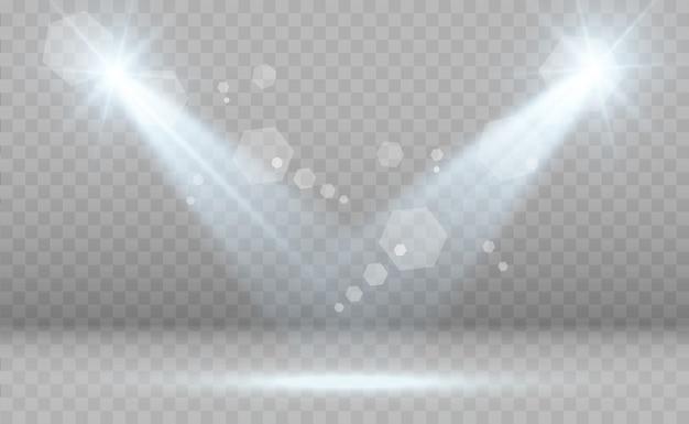 Biała scena z reflektorami. światła z błyszczy na przezroczystym tle.