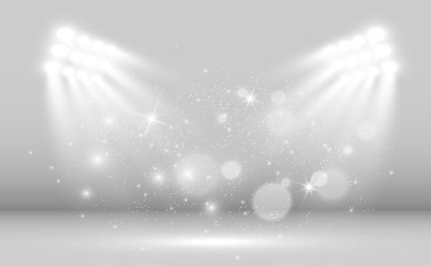 Biała scena z reflektorami światła z iskierkami na przezroczystym tle