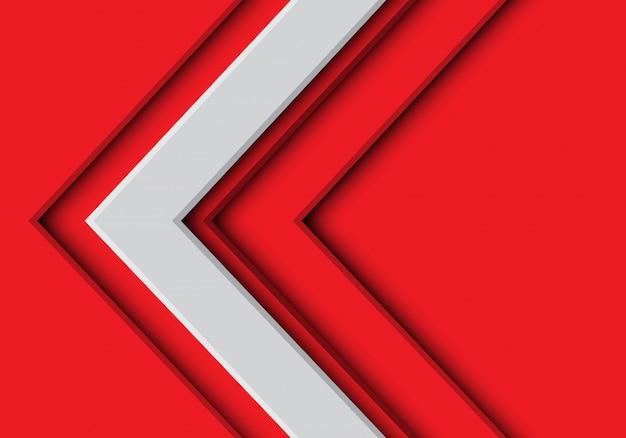 Biała strzałka kierunek na czerwonym futurystycznym tle.