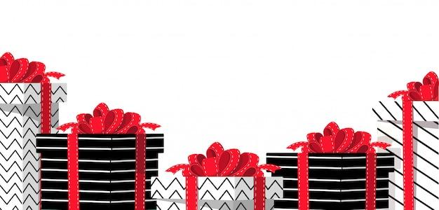 Biała tablica z pudełkami na prezenty.
