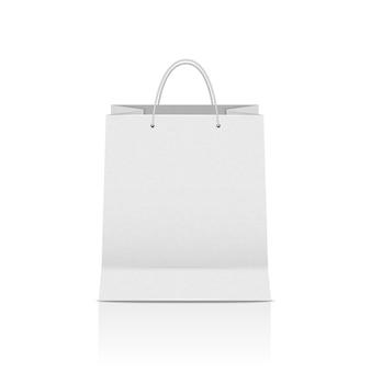 Biała torba na zakupy, realistyczna papierowa torba z uchwytami i cień na białym tle.