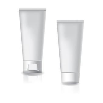 Biała tubka kosmetyczna z dwoma białymi czapkami i zakrętką.