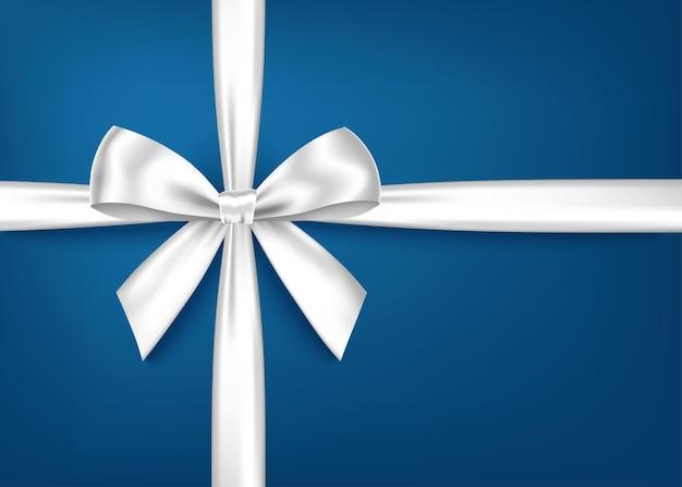 Biała wstążka prezent i łuk na białym tle na niebiesko