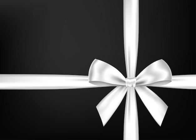 Biała wstążka prezent i łuk na czarnym tle