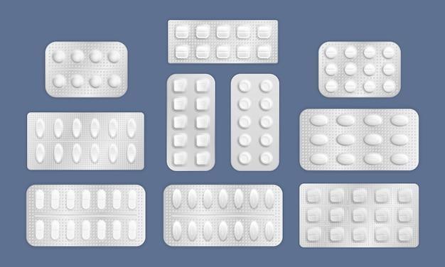 Białe 3d blister tabletki. realistyczne tabletki w opakowaniu do leczenia chorób i bólu. opakowania antybiotyków z lekami realistycznymi. tabletki leku i kapsułki, białe leki 3d i witaminy. .