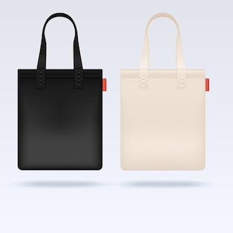 Białe i czarne torby materiałowe z tkaniny