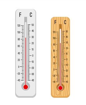 Białe i drewniane termometry lub mierniki temperatury na białym